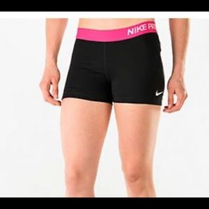 Pink and black Nike Pros